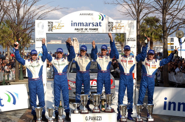 2002 World Rally ChampionshipInmarsat Corsica Rally, 8th-10th March 2002.The Peugeot team celebrate their 1 - 2 - 3 on the podium.Photo: Ralph Hardwick/LAT