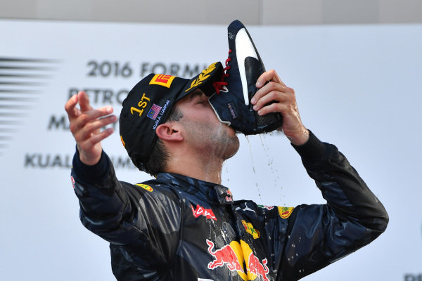 Race winner Daniel Ricciardo (AUS) Red Bull Racing drinks champagne from his shoe / boot on the podium at Formula One World Championship, Rd16, Malaysian Grand Prix, Race,  Sepang, Malaysia, Sunday 2 October 2016. BEST IMAGE