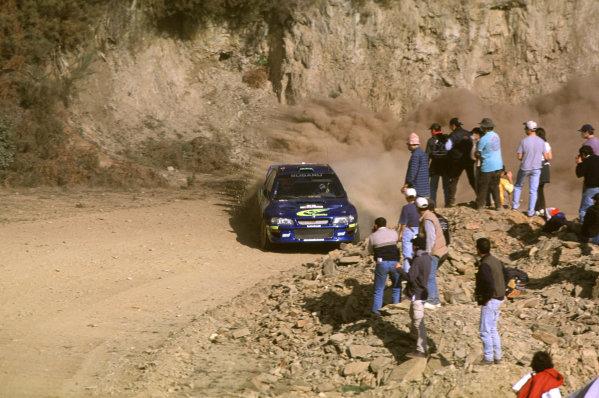 FIA World Rally ChampionshipPortuguese Rally, Porto, Portugal.16-19th March 2000.Richard Burns and Robert Reid (Subaru) action.World - LAT PhotographicTel: +44 (0) 181 251 3000Fax: +44 (0) 181 251 3001e-mail: latdig@dial.pipex com