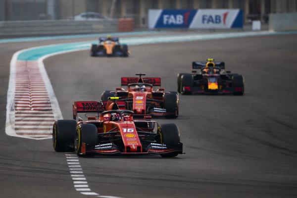 Charles Leclerc, Ferrari SF90, leads Sebastian Vettel, Ferrari SF90, Alexander Albon, Red Bull RB15, and Carlos Sainz Jr., McLaren MCL34