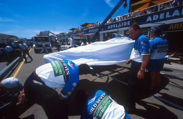 1994 Australian Grand Prix.Adelaide, Australia.11-13 November 1994.Michael Schumacher's damaged Benetton B194 Ford is brought back to the pits after its collision with Hill's Williams.Ref-94 AUS 08.World Copyright - LAT Photographic