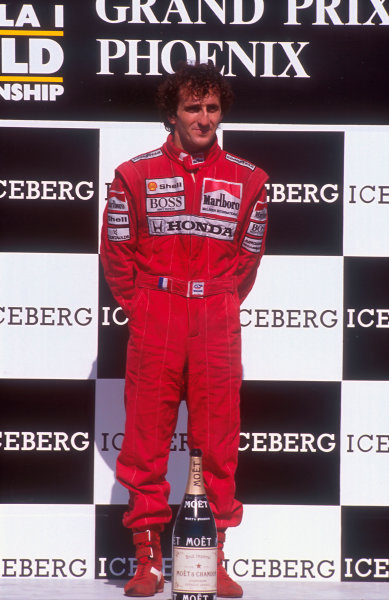 1989 United States Grand Prix.Phoenix, Arizona, USA.2-4 June 1989.Alain Prost (McLaren Honda) 1st position on the podium.  Ref: 89USA32. World Copyright - LAT Photographic