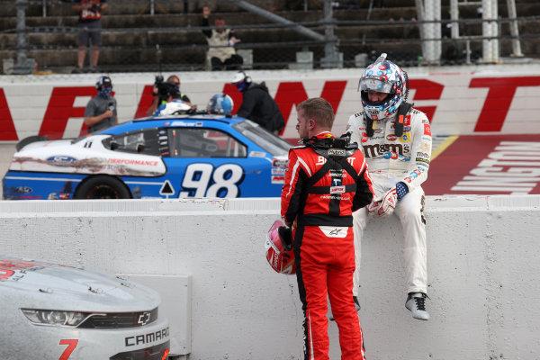 Kyle Busch, Joe Gibbs Racing Toyota and Justin Allgaier, JR Motorsports Chevrolet, talk after the race, Copyright: Chris Graythen/Getty Images.