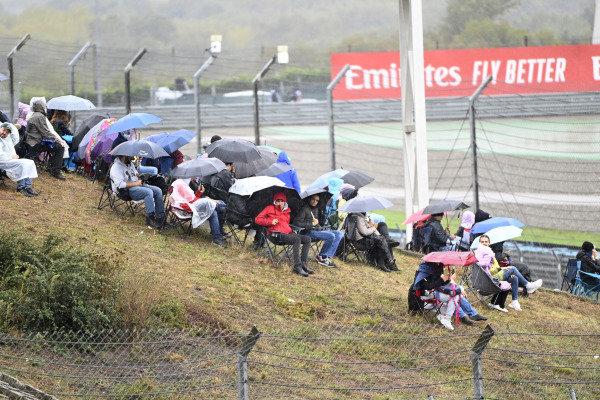 Fans watching race in rain