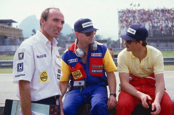 1985 Brazilian Grand Prix.Jacarepagua, Rio De Janeiro, Brazil.5-7 April 1985.Williams team boss Frank Williams with Peter Collins and Nigel Mansell.Ref-85 BRA 35.World Copyright - LAT Photographic