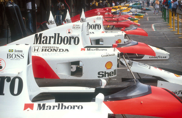 1991 Mexican Grand Prix.Mexico City, Mexico.14-16 June 1991.The teams bodywork parts adorn the length of the pit lane.Ref-91 MEX 19.World Copyright - LAT Photographic
