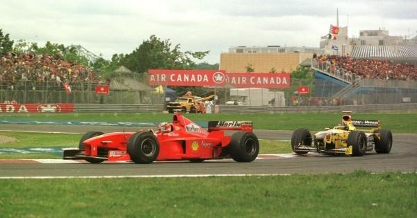1998 Canadian Grand Prix.Montreal, Quebec, Canada.5-7 June 1998.Michael Schumacher (Ferrari F300) leads Damon Hill (Jordan 198 Mugen-Honda) at the start. Schumacher finished in 1st position.World Copyright - Steve Etherington/LAT Photographic