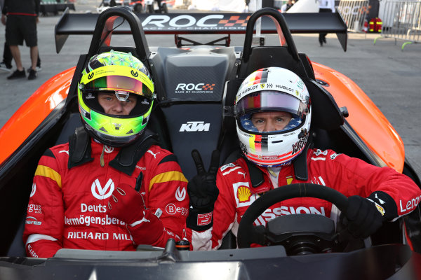 Sebastian Vettel (GER) prepares to drive with Mick Schumacher (GER) as a passenger