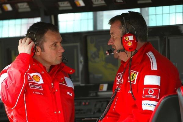 (L to R): Stefano Domenicali (ITA) Ferrari Director of F1 Racing Activities talks with Nigel Stepney (GBR) Ferrari Race Technical Manager. Formula One World Championship, British Grand Prix, Rd 11, Practice, Silverstone, England, 9 July 2004.  DIGITAL IMAGE