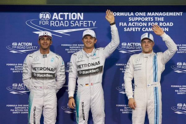 Yas Marina Circuit, Abu Dhabi, United Arab Emirates. Saturday 22 November 2014. Top three qualifiers Nico Rosberg, Mercedes AMG, Lewis Hamilton, Mercedes AMG, and Valtteri Bottas, Williams F1. World Copyright: Steve Etherington/LAT Photographic. ref: Digital Image SNE12309