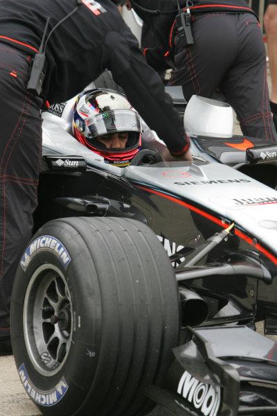 2005 Formula One Testing Silverstone, England, 1st June 2005Juan Pablo Montoya, McLaren Mercedes MP4-20 is pushed back into the garage. World Copyright: Glenn Dunbar/ LAT Photographic Digital Image only