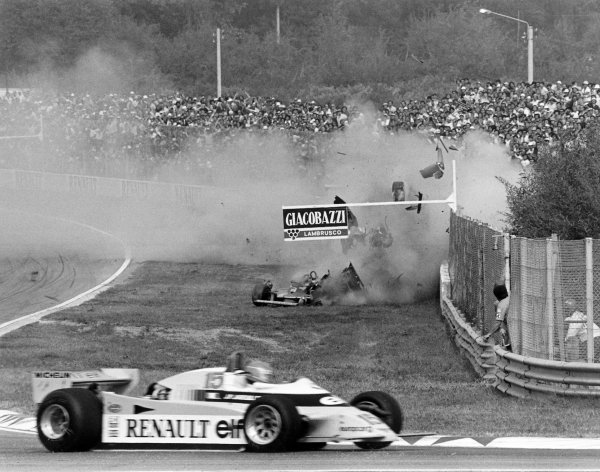 1980 Italian Grand Prix.Imola, Italy. 12-14 September 1980.Jean-Pierre Jabouille (Renault RE20) passes as Gilles Villeneuve (Ferrari 312T5) crashes out of the race. Accident.World Copyright: LAT PhotographicRef: 14056/31