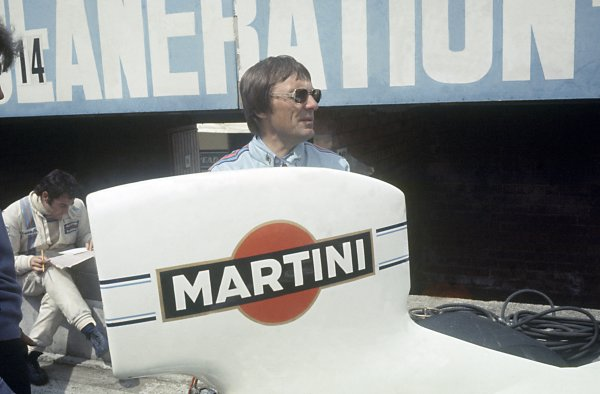 1975 Belgian Grand Prix.Zolder, Belgium. 25 May 1975.Bernie Ecclestone stands in front of Carlos Pace, Martini Brabham BT44B-Ford, 8th position, portrait.World Copyright: LAT PhotographicRef: 35mm transparency 75BEL