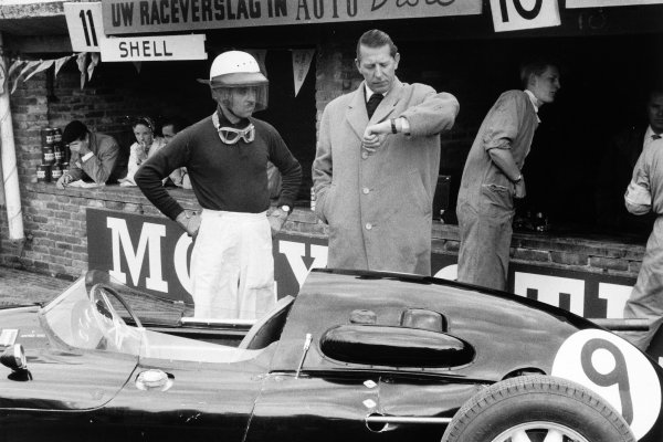 1958 Dutch Grand Prix Zandvoort, Holland. 25 May 1958 Team Owner Rob Walker checks the time with his driver Maurice Trintignant, Cooper T45-Climax, 9th position, portrait, helmet, atmosphere World Copyright: LAT PhotographicRef: Autosport b&w print