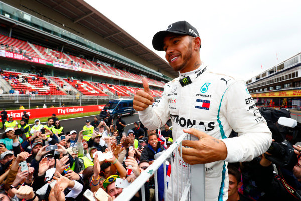 Lewis Hamilton, Mercedes AMG F1, 1st position, celebrates with fans.