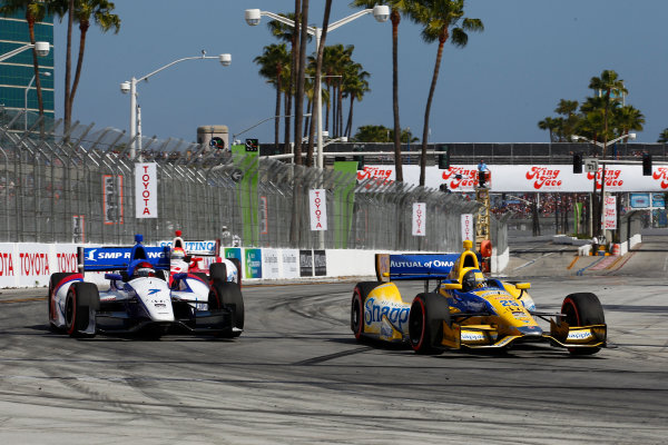 11-13 April, 2014, Long Beach, California USA Marco Andretti passes Mikhail Aleshin ©2014, Phillip Abbott LAT Photo USA