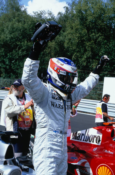 2004 Belgian Grand Prix. Spa Francorchamps, Belgium. 27th - 29th August. Kimi Raikkonen, McLaren Mercedes MP4/19B celebrates his victory. World Copyright:LAT Photographic Ref:35mm Image A02
