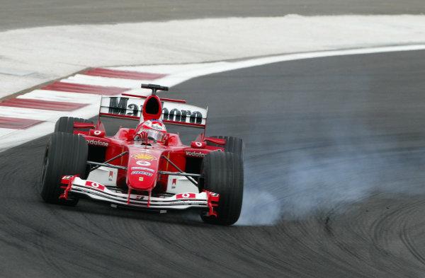 2004 Bahrain Grand Prix - Sunday Race, 2004 Bahrain Grand Prix Bahrain International Circuit, Manama, Bahrain. 4th April 2004Rubens Barrichello, Ferrari F2004 locks a front wheel. Action. World Copyright: Steve Etherington/LAT Photographic ref: Digital Image Only
