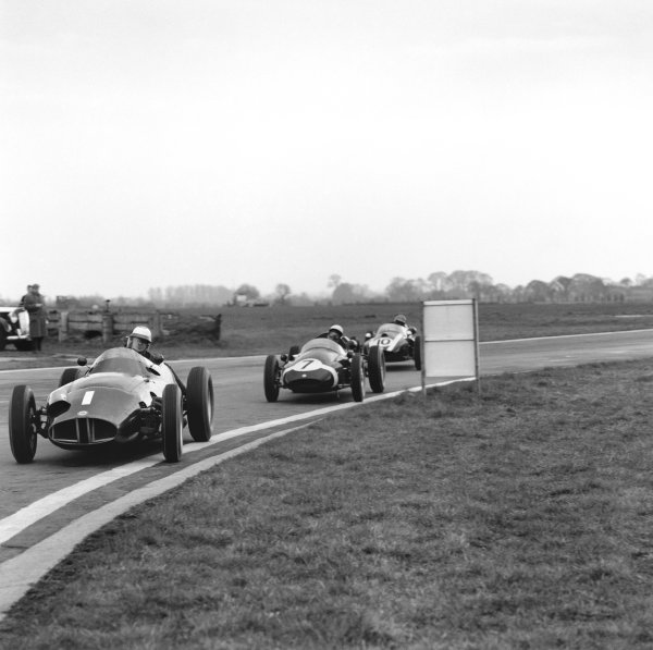 Goodwood, Sussex, Great Britain. 30th March 1959.Stirling Moss (Cooper F1-Climax), 1st position, behind Harry Schell (BRM 25), 3rd position, action.World Copyright: LAT Photographic.Ref: 3771.