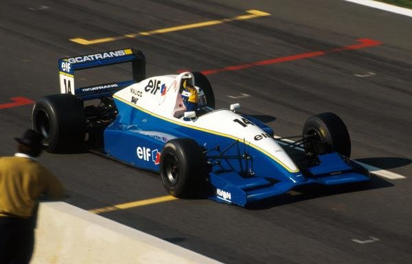 Race winner Olivier Panis (FRA) DAMS Reynard 93D Cosworth AC crosses the finish line.