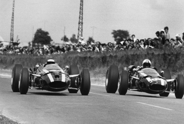 Reims, France. 3rd July 1966.Jochen Rindt (Cooper T81-Maserati), 4th position, left, and Chris Amon (Cooper T81-Maserati), 8th position, side-by-side, action.World Copyright: LAT Photographic