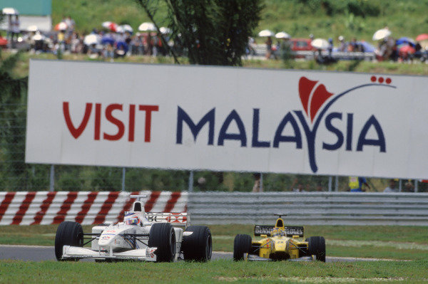 Sepang, Kuala Lumpur, Malaysia. 15th - 17th October 1999.Rubens Barrichello (Stewart SF3-Ford), 5th position, action. World Copyright: LAT Photographic.Ref: Colour Transparency.
