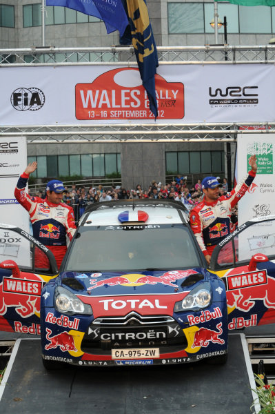 Sebastien Loeb (FRA) and Daniel Elena (MC), Citroen DS3 WRC on the podium. FIA World Rally Championship, Rd10, Wales Rally GB, Day Three, Cardiff, Wales, 16 September 2012.