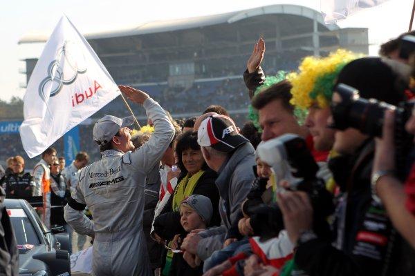 Race winner Jamie Green (GBR), AMG Mercedes celebrates with his team in parc ferme.DTM, Rd10, Hockenheim, Germany, 22-23 October 2011 World Copyright: LAT Photographicref: Digital Image dne1123oc54