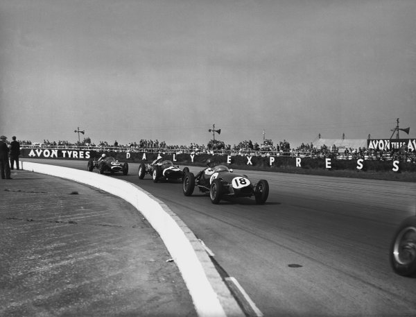 Silverstone, England. 3rd position May 1958.Cliff Allison (Lotus 12-Climax), 6th position, leads Stirling Moss (Cooper T43-Climax), retired, and  Bruce McLaren (Cooper T45-Climax), 9th position, action. World Copyright: LAT Photographic.Ref:  18507 - 55.