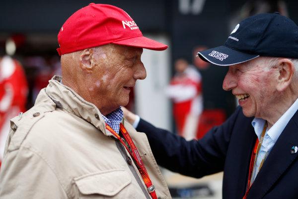 Silverstone, Northamptonshire, UK Sunday 10 July 2016. Niki Lauda with John Surtees. World Copyright: Glenn Dunbar/LAT Photographic ref: Digital Image _V2I0007