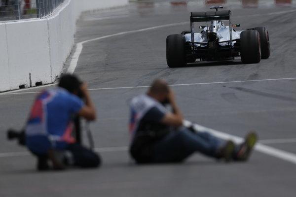 Circuit Gilles Villeneuve, Montreal, Canada. Friday 6 June 2014. Photographers take aim at Kevin Magnussen, McLaren MP4-29 Mercedes. World Copyright: Alastair Staley/LAT Photographic. ref: Digital Image _R6T5572