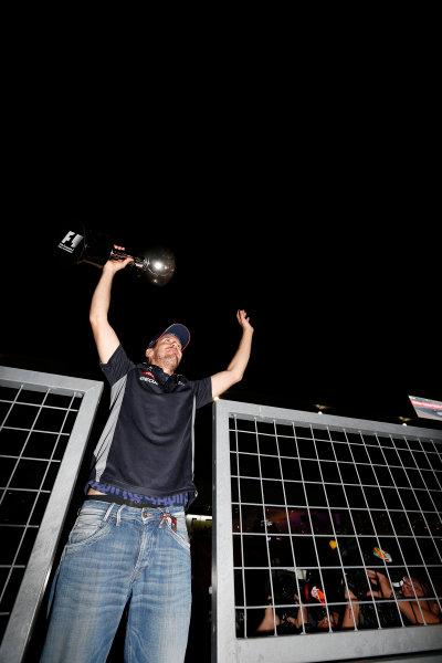 Suzuka Circuit, Suzuka, Japan.  Sunday 13th October 2013.  Sebastian Vettel, Red Bull Racing, 1st position, waves to the crowd whilst celebrating victory. World Copyright: Charles Coates/LAT Photographic  ref: Digital Image _N7T7481