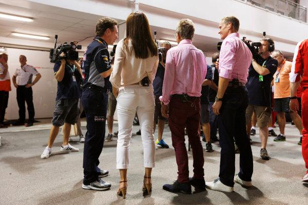 Marina Bay Circuit, Singapore. Saturday 21st September 2013. Christian Horner, Team Principal, Red Bull Racing talks to BBC TV presenters Suzi Perry, Eddie Jordan and David Coulthard. World Copyright: Charles Coates/LAT Photographic. ref: Digital Image _N7T5529