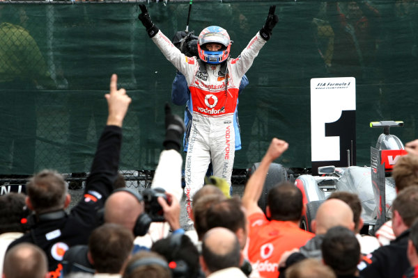 Circuit Gilles Villeneuve, Montreal, Canada12th June 2011Jenson Button, McLaren MP4-26 Mercedes, 1st position, celebrates in Parc Ferme. Portrait. Helmets. Finish. World Copyright: Andy Hone/LAT Photographicref: Digital Image 2_LC0904
