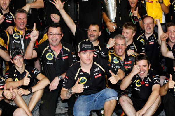 Yas Marina Circuit, Abu Dhabi, United Arab Emirates Sunday 4th November 2012. Kimi Raikkonen, Lotus GP celebrates winning the 2012 Abu Dhabi grand prix with his team. World Copyright:Charles Coates/  ref: Digital Image _N7T7774