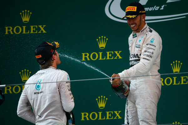 Shanghai International Circuit, Shanghai, China. Sunday 12 April 2015. Lewis Hamilton, Mercedes AMG, 1st Position, sprays Champagne at Nico Rosberg, Mercedes AMG, 2nd Position. World Copyright: Andrew Hone/LAT Photographic. ref: Digital Image _ONZ1397