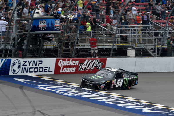 12-13 June, 2015, Brooklyn, Michigan USA Kyle Busch, Monster Energy Toyota Camry crosses the line for the win under the checkered flag ?2015 Scott R LePage  LAT Photo USA