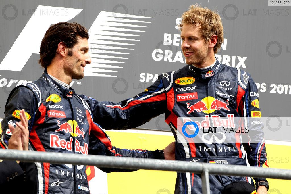 Spa-Francorchamps, Spa, Belgium28th August 2011.Sebastian Vettel, Red Bull Racing RB7 Renault, 1st position, and Mark Webber, Red Bull Racing RB7 Renault, 2nd position, on the podium. Portrait. Podium. World Copyright: Andy Hone/LAT Photographicref: Digital Image CI0C2445