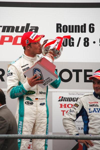 Motegi, Japan. 8th - 9th August 2009.Rd6  - Winner Andre Lotterer ( #36 PETRONAS TEAM TOM'S ), podium, portrait.World Copyright: Yasushi Ishihara/LAT Photographicref: Digital Image 2009FN_Rd6_008