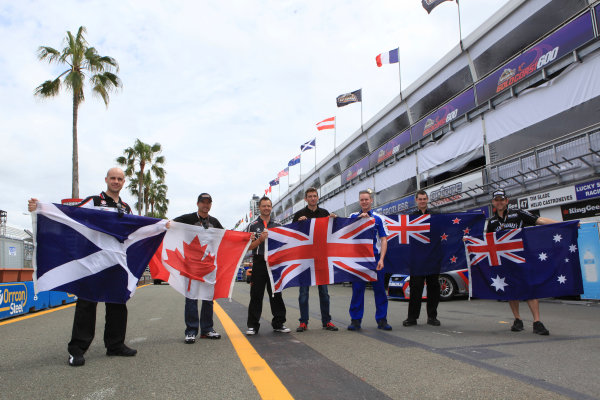 Marino Franchitti of the UK of Lucas Dumbrell Motorsport (L-R), Alex Tagliani of Kelly Racing, Andy Priaulx of Triple Eight Racing, Oliver Gavin of Kelly Racing, Richard Lyons of Ford Performance Racing, Shane Van Gisbergen of Stone Brothers Racing and Todd Kelly of Kelly Racing hold their national flags during the Armor All Gold Coast 600, event 11 of the 2011 V8 Supercars Championship at the Queensland Raceway, Ipswich, Queensland, October 20, 2011.World Copyright: Mark Horsburgh/LAT Photographicref: flags-EV11-11-0953