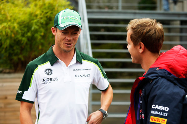 Spa-Francorchamps, Spa, Belgium. Friday 22 August 2014. Andre Lotterer, Caterham F1, and Sebastian Vettel, Red Bull Racing. World Copyright: Charles Coates/LAT Photographic. ref: Digital Image _J5R9279