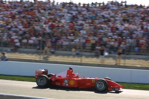 2001 French Grand Prix - RaceMagny-Cours, France. 1st July 2001Race winner Michael Schumacher, Ferrari F2001, action.World Copyright - LAT Photographicref: 8 9 MB Digital File only