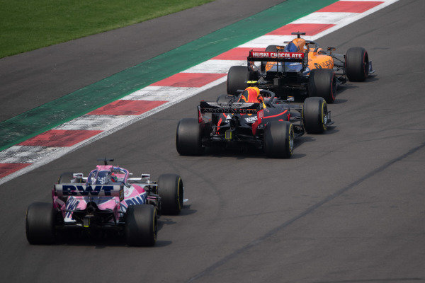 Carlos Sainz Jr., McLaren MCL34, leads Alexander Albon, Red Bull RB15, and Sergio Perez, Racing Point RP19