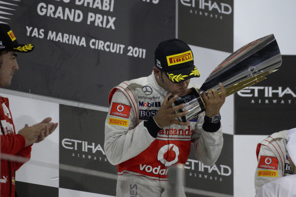 Lewis Hamilton, 1st position, celebrates on the podium.