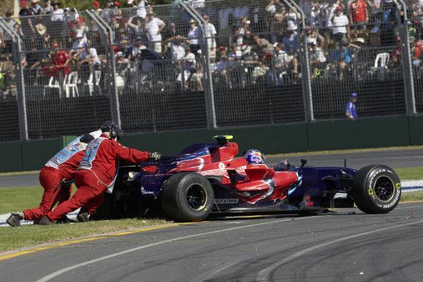 Marshals push Sebastian Vettel, Toro Rosso STR2B Ferrari back on track.