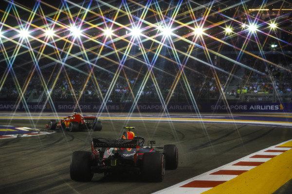 Sebastian Vettel, Ferrari SF71H, leads Max Verstappen, Red Bull Racing RB14
