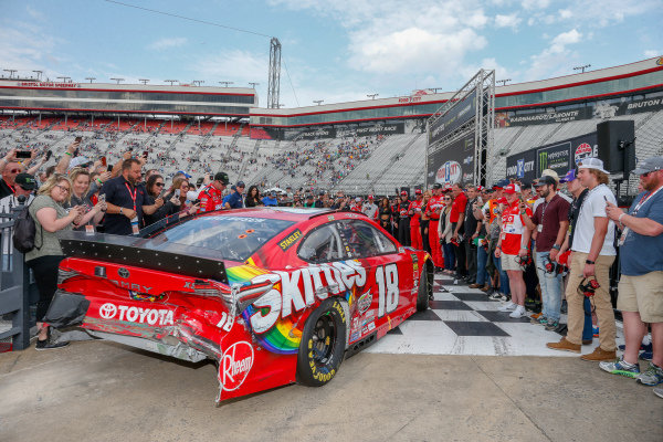 #18: Kyle Busch, Joe Gibbs Racing, Toyota Camry Skittles pulling into victory lane