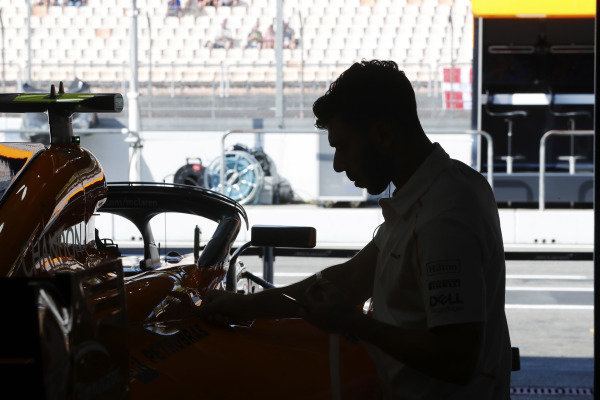 A mechanic works on the Stoffel Vandoorne McLaren MCL33 Renault in the team's garage.