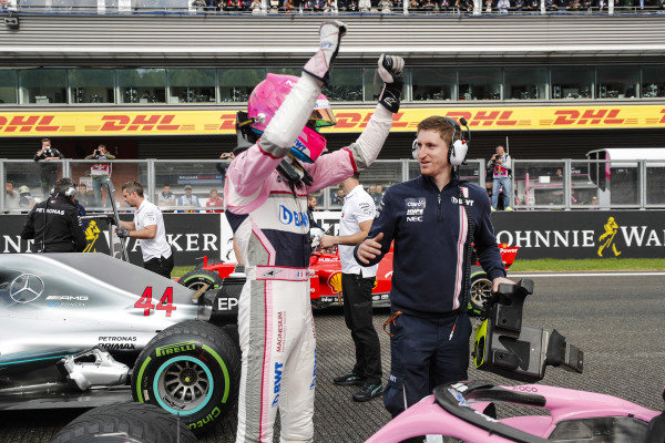 Esteban Ocon, Racing Point Force India, celebrates qualifying in third place with colleagues.