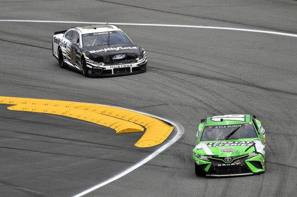 #18: Kyle Busch, Joe Gibbs Racing, Toyota Camry Interstate Batteries and #10: Aric Almirola, Stewart-Haas Racing, Ford Mustang Smithfield